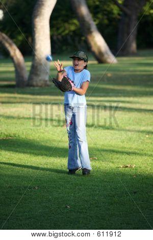Girl Catching A Ball
