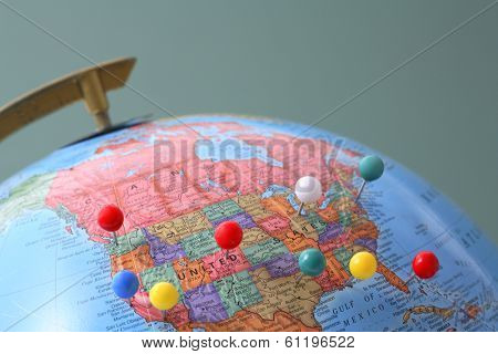American cities on part of globe isolated by pins
