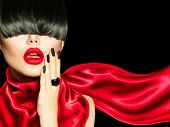 Sexy Model Woman Portrait. High Fashion Girl with Trendy Hair style, Make up and Manicure. Long Black Fringe Hairstyle poster