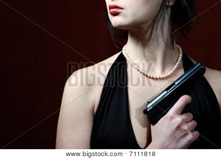 Beautiful Woman In Evening Dress With Gun