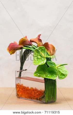 Floral Arangement With Calla Lilies, Anthurium  And Greenery On