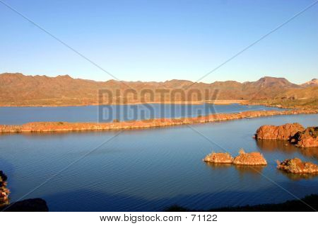 this is a photo of lake havasu in the spring. the mountains and water make for a beautiful scene. poster