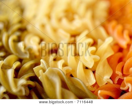 Close-up Of Red, Green And White Pasta