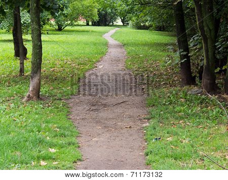 Long gravel path in the park next to the cemetery