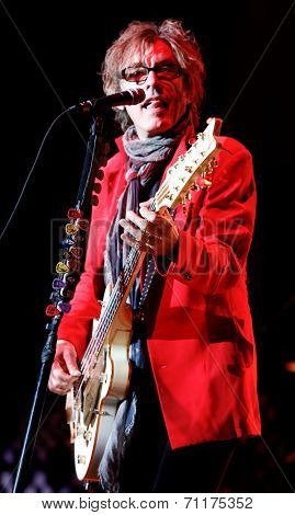 HUNTINGTON, NY-AUG 26: Bassist Tom Petersson of Cheap Trick performs in concert at the Paramount on August 26, 2014 in Huntington, New York.