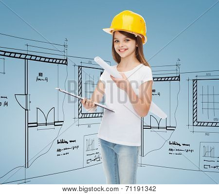childhood, construction, architecture and people concept - smiling little girl in protective helmet with clipboard and blueprint