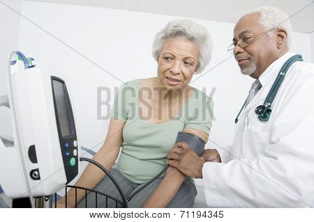Elderly woman and senior practitioner during medical check-up poster