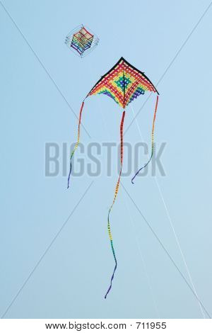 A Colorful Kite Soaring In The Blue Sky