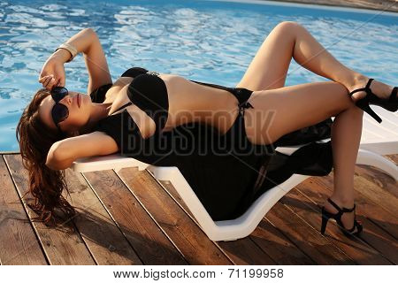Sexy Girl With Dark Hair In Bikini And Sunglasses