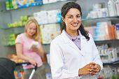 portrait of cheerful pharmacist chemist woman in pharmacy drugstore poster