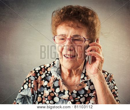 Seniors talking mobile phone. Old adult mature woman