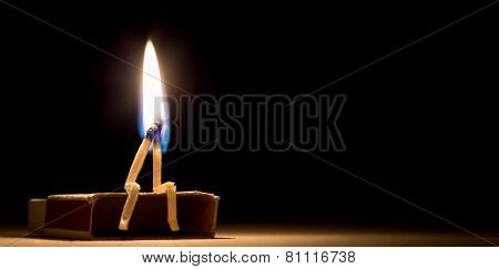 Two Matches Burning Sitting Together On The Matchbox In The Dark Copy Space