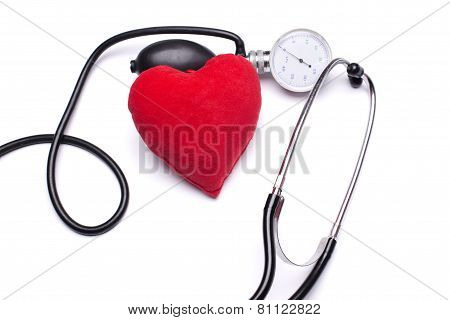 Stethoscope, red heart and hemopiezometer on a white background