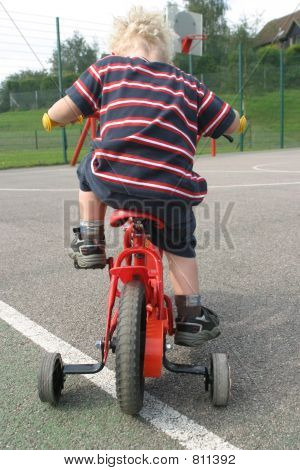 Trying to cycle on new bike with training wheels