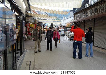 Tourists Visit Omotesando Shopping Street In Miyajima, Japan