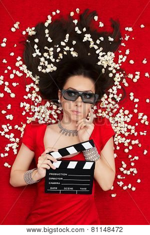 Puzzled Girl with 3D Cinema Glasses,  Popcorn and Director Clapboard