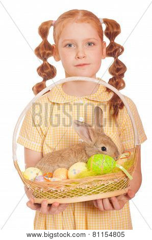 Little girl with a white rabbit in basket easter eggs