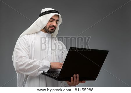 Arab working with laptop