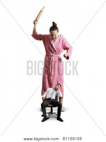displeased housewife screaming at her lazy husband. isolated on white background
