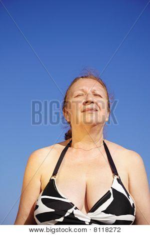 Senior Woman Relax On The Beach