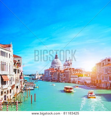 Venice, Italy. Grand Canal and the Salute at sunny day. Tourist boats View from Ponte dell Accademia