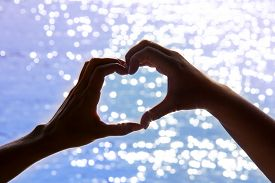 Love Shape Hand Silhouette On The Background Of The Sea