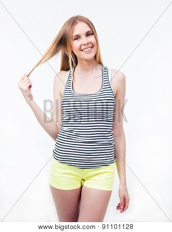 Smiling young woman looking at camera. Isolated on a white background