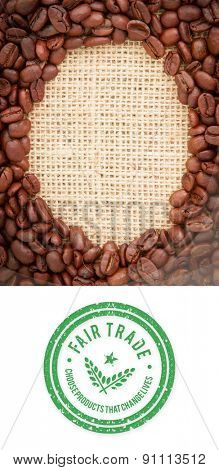 Fair Trade graphic against coffee beans with oval indent for copy space