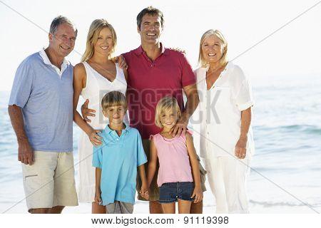 Portrait Of Three Generation Family On Beach Vacation