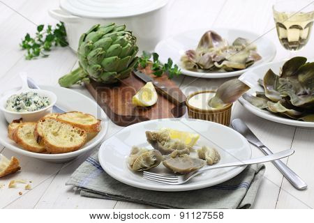 eating boiled artichoke, italian cuisine
