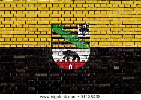 Flag Of Saxony Anhalt Painted On Brick Wall