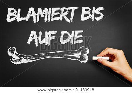 Hand writing the German saying