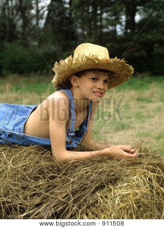 Boy On Hay Bale  Pensive