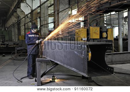 Metalworkers Polishing Welds Metal Structures, Producing Fountain Of Sparks.