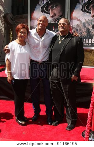 LOS ANGELES - MAY 19:  Ata Johnson, Dwayne Johnson, Rocky Johnson at the Dwayne Johnson Hand and Foot Print Ceremony at the TCL Chinese Theater on May 19, 2015 in Los Angeles, CA