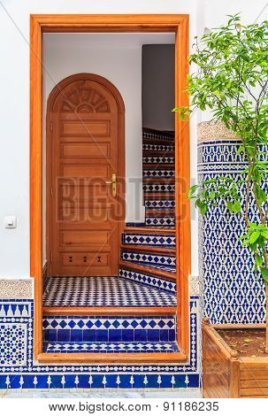 Fes, Morocco - May 11, 2013: Mosaic decorated stairs leading to the second floor in the Inner courtyard in a Moroccan riad. poster
