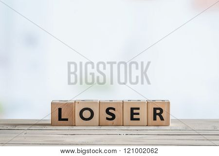 Loser Sign On A Wooden Desk