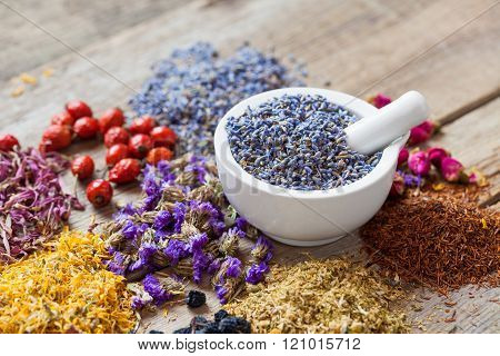 Mortar Of Dry Lavender, Healing Herbs, Herbal Tea Assortment And Healthy Berries On Table.
