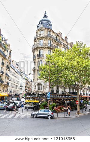 PARIS, FRANCE - SEPTEMBER 20, 2012: Bistro in the streets of Montmartre in Paris, France. The place is famous by its cafes artists shops and night life.