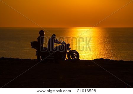 Two People In The Motorcycle At Sunset On The Black Sea
