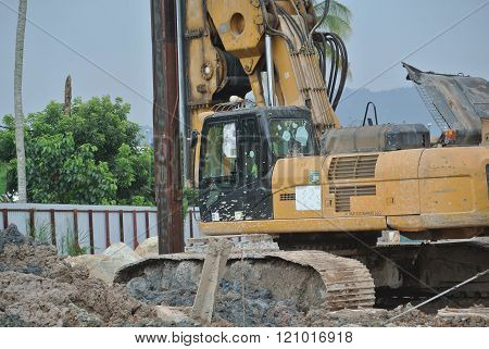MALACCA, MALAYSIA - FEBRUARY 26, 2015: Bore pile rig machine at the construction site in Malacca, Malaysia. The machine used to driven pile for building foundation work.