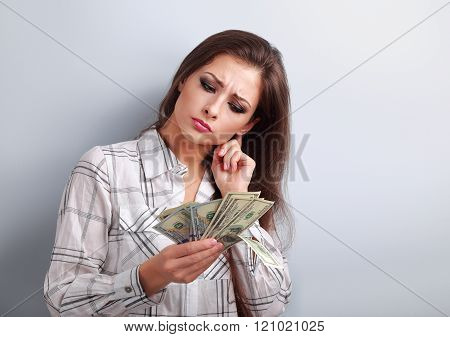 Concentrated thinking business woman thinking where invest money and how to earning more dollars