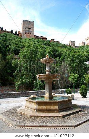 Stone fountain by Alhambra, Granada.