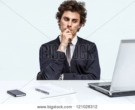 Doubter Businessman sitting in his office.