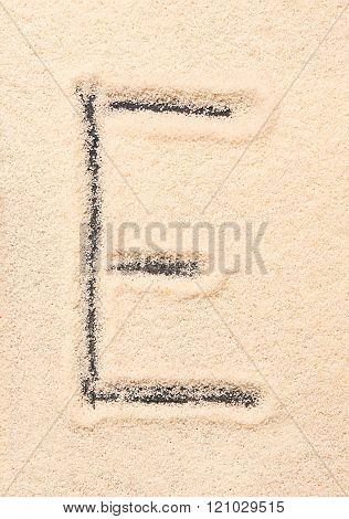 E Letter Written On Sand