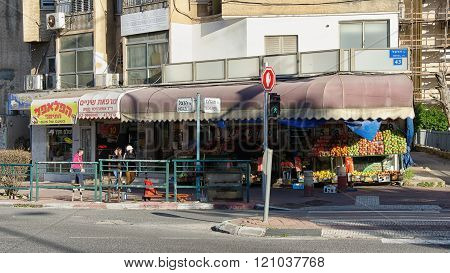 Greengrocers shop with faded red sunshade canopy