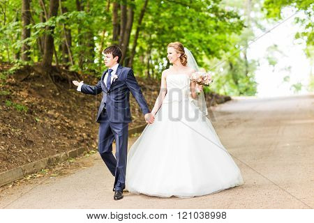 Wedding couple on the  road