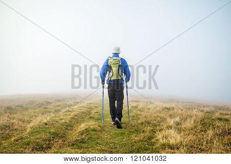 Man trekking in the fog