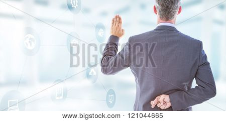 Rear view of businessman taking oath with fingers crossed against modern room overlooking city