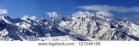 Panoramic view on snowy mountains in nice sunny day
